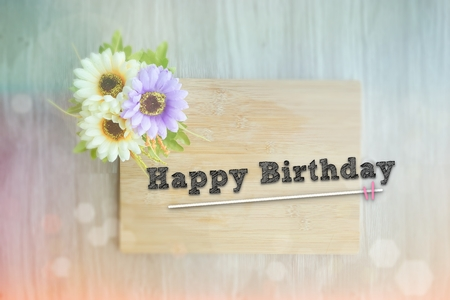 HAPPY BIRTHDAY words on the wooden background vintage retro or rustic style with flowers Фото со стока