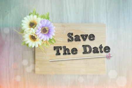 SAVE THE DATE words on the wooden background vintage retro or rustic style with flowers Фото со стока