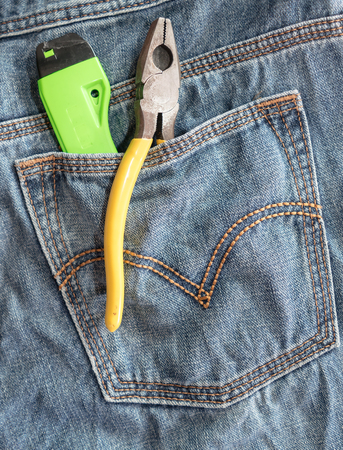 Several tools on a denim jeans pocket