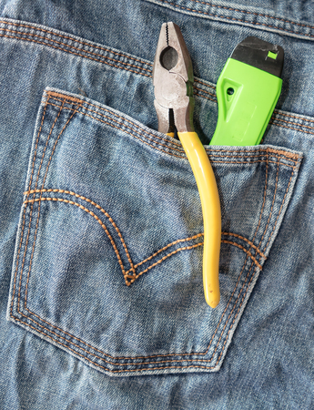Several tools on a denim jeans pocket