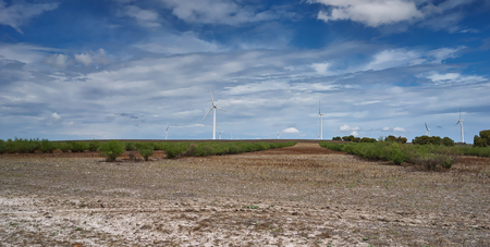 Wind turbines against a blue sky Stock Photo