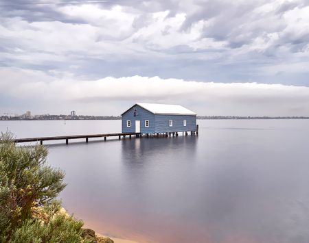 Blue boathouse in the Swan River Perth, Australia