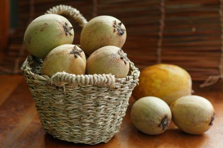 small basket: Raw Sapodilla in small basket