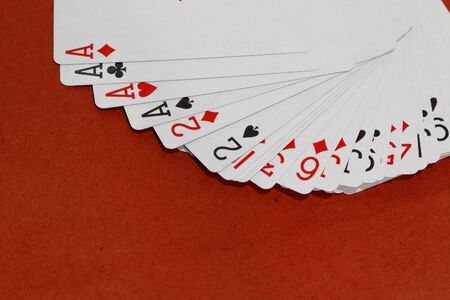 Playing card games on red background