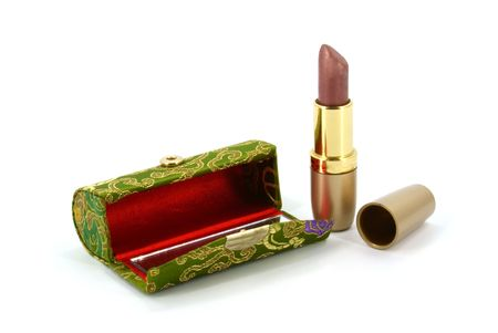 enchant: lipstick and case on white background