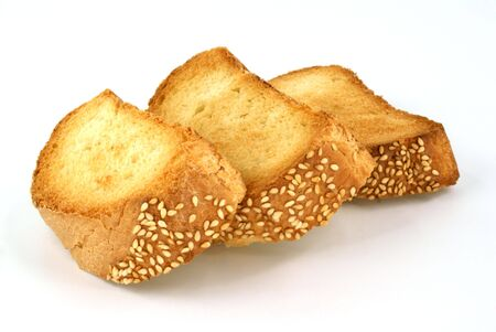 three toasted piece of bread against white background