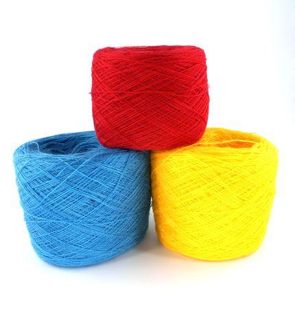 three bobbin of thread against white background photo
