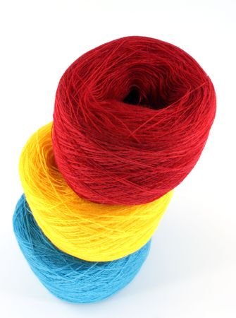 three bobbin of thread against white background Stock Photo - 5884110