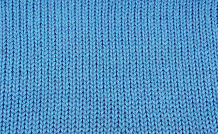 blue knitted cloth as texture photo