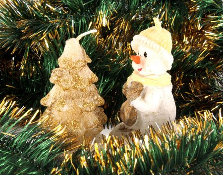 Christmas wax figure with bright green tinsel  photo