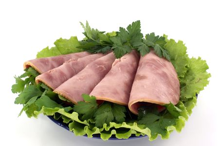 threaded ham with salad and parsley on plate Stock Photo