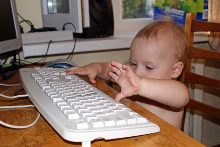 baby working in computer photo