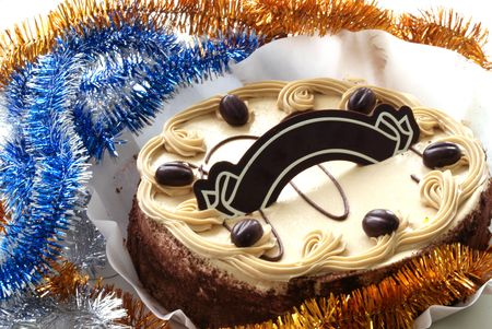 sponge cake with chocolate plate against tinsel