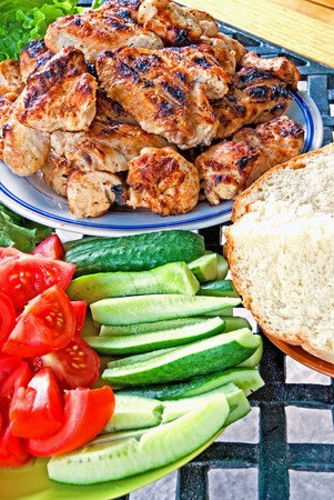 grilled meat with vegetables on table