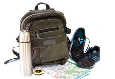 knapsack with sneakers against white background photo