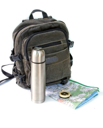 knapsack with thermos against white background photo