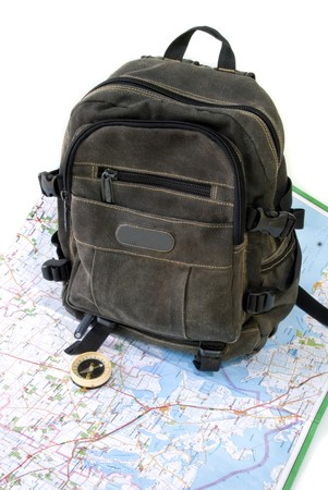 knapsack with map against white background Stock Photo