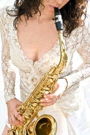 girl is playing the sax photo