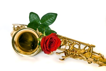 alto sax with rose against white background