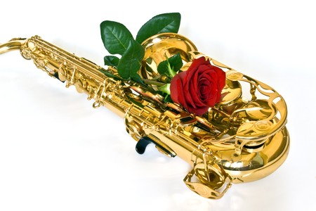 alto sax with rose against white background photo