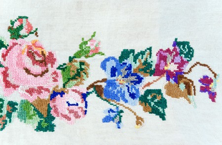 flowers embroidered with cross-stitch on linen Stock Photo