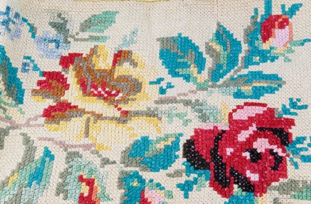 flowers embroidered with cross-stitch on linen photo