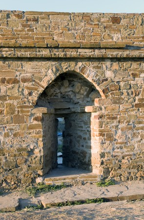 mediaeval: loophole in wall of mediaeval fortress