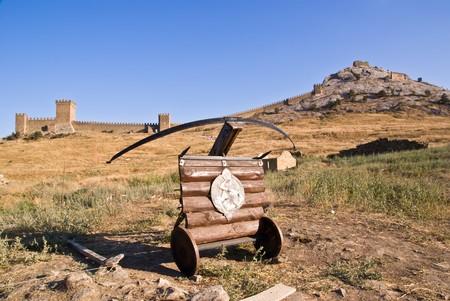 arbalest: ancient arbalest against Genoese tower Stock Photo