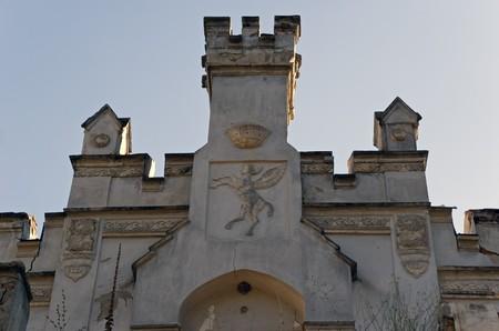baroque gate: family emblem on destroyed castle