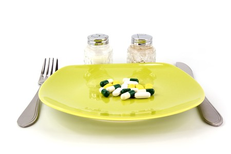 pills as dinner on plate