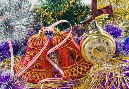 Christmas bell with pink ribbon on tinsel photo