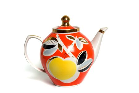 red with gold teapot on white background photo