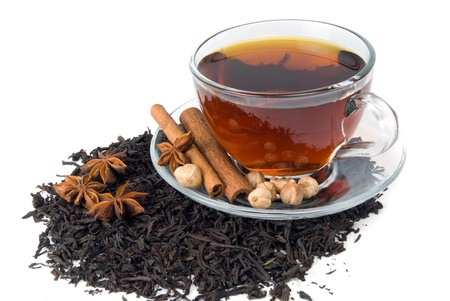 cup of tea and spice on heap of tea leaf Stock Photo - 8682709
