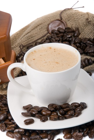 black coffee in cup against coffee beans Stock Photo - 9234455
