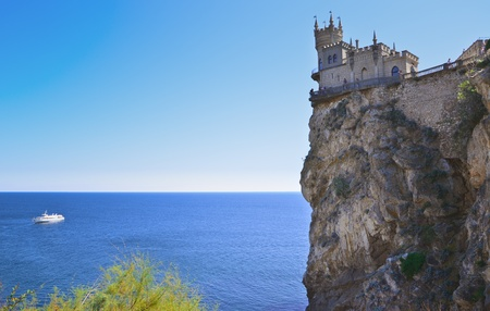 old castle on rock over the sea photo