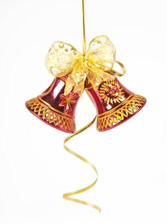 Christmas bell with red ribbon against white background photo