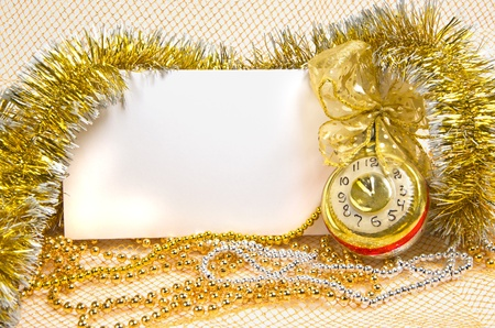 christmas clock with tinsel and postcard on beads photo