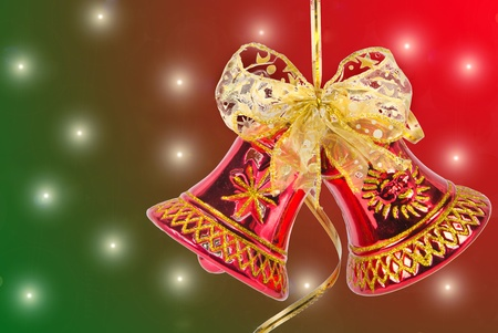 Christmas bell with red ribbon against light background photo