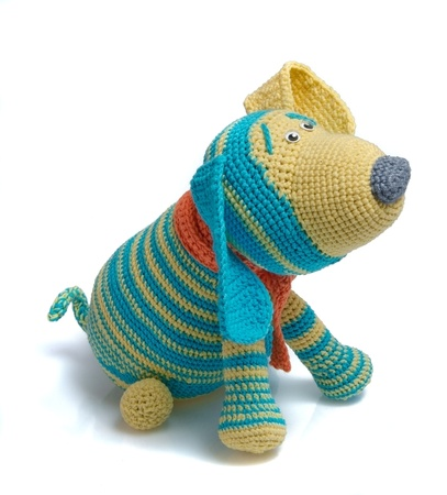 toy as knitted dog on white background