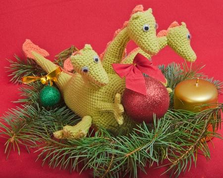 christmas dragon: christmas decorations as dragon with ball on red