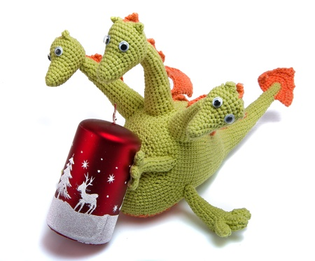Toy As Knitted Dragon With Christmas Candle Stock Photo Picture And