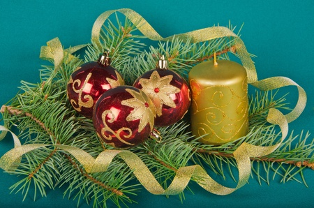 christmas decorations with candle and spruce on green photo