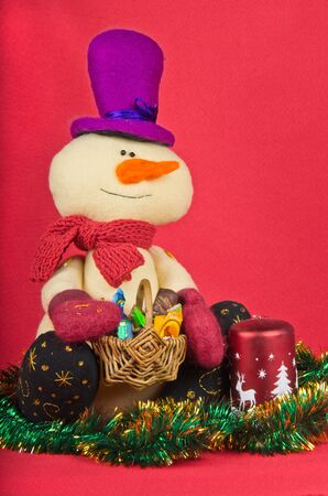 christmas decoration and snowman on red photo