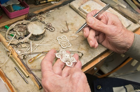 hands of  jeweller at work