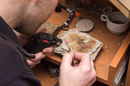hands of  jeweller at work