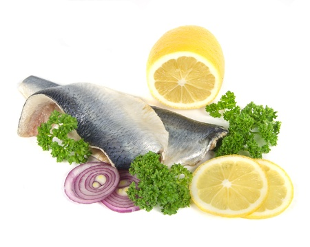 herring with herbs and lemon on white background Stock Photo