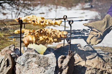 barbecue among snow in spring picnic photo