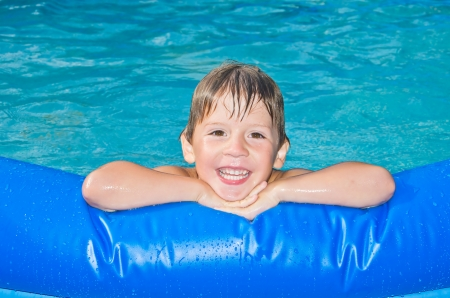 happy boy in the swimming pool Stock Photo