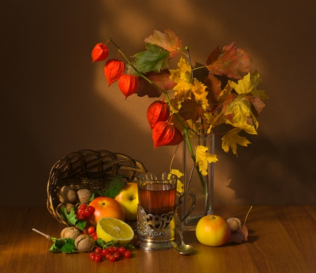 still life of autumn fruits and tea photo