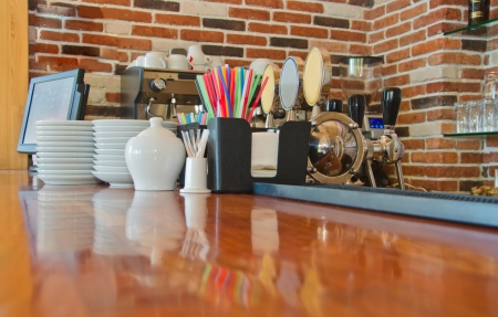horizontal bar: bar counter with utensil in cafe